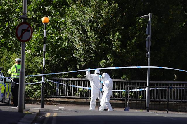 Forensic officers work near Forbury Gardens in Reading town centre following Saturday's terror attack. (PA)