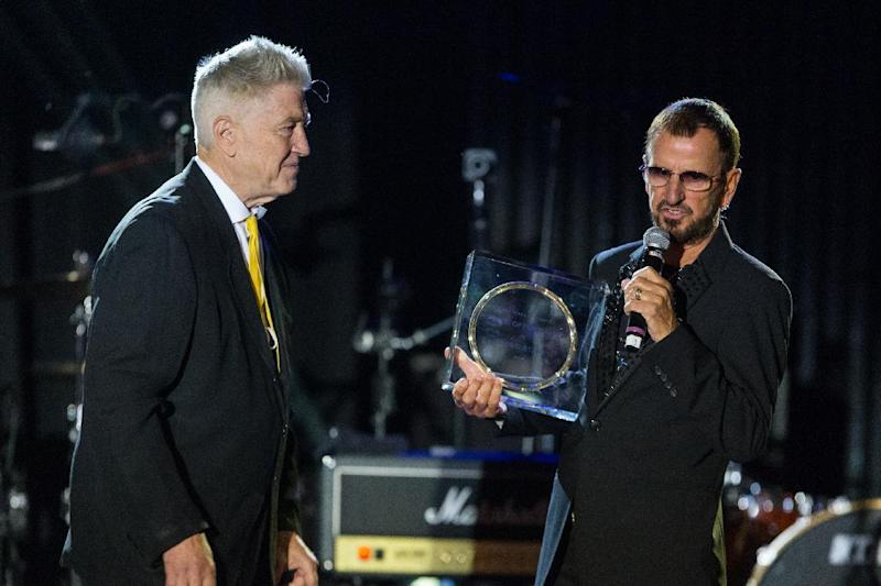 "Director David Lynch, left, presents musician Ringo Starr with the ""Lifetime of Peace & Love Award"" on stage during the David Lynch Foundation Honors Ringo Star ""A Lifetime of Peace & Love"" event held at the El Rey Theatre on Monday, Jan. 20, 2014, in Los Angeles. (Photo by Paul A. Hebert/Invision/AP)"