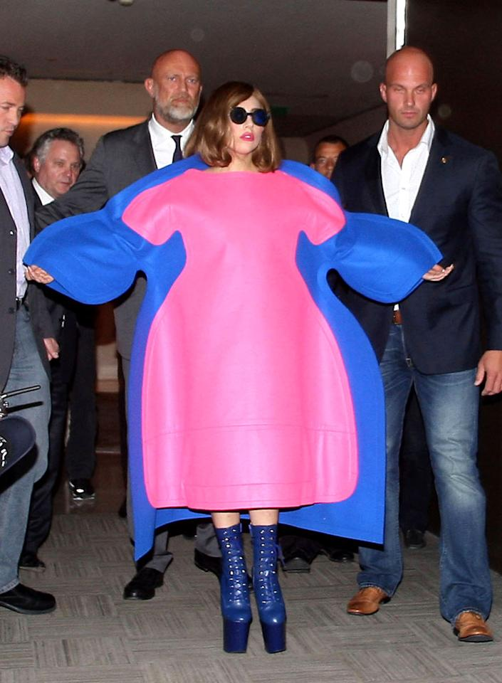 "<p class=""MsoNormal""></p><p class=""MsoNormal"">  <p class=""MsoNormal"">Lady Gaga has admitted she's put on a few pounds – 25 to be exact – and we're sure she donned this big bizarre pink-and-blue outfit to show she has a sense of humor about her weight gain, but couldn't she camouflage her slightly fuller figure with a cute caftan versus this garish getup? (9/22/2012)</p>"