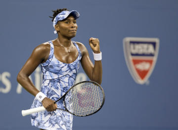 Aug 27, 2014; New York, NY, USA; Venus Williams (USA) celebrates recording match point in her match against Timea Bacsinszky (SUI) on day three of the 2014 U.S. Open tennis tournament at USTA Billie Jean King National Tennis Center. (Susan Mullane-USA TODAY Sports)