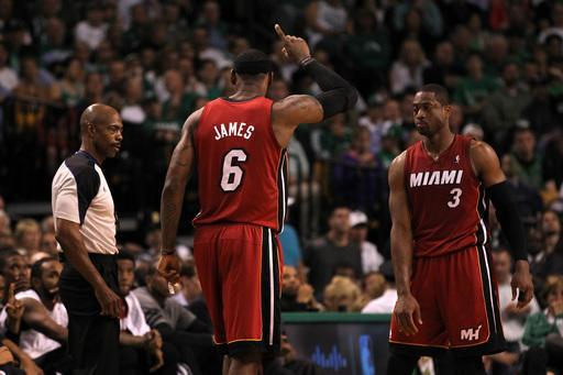 BOSTON, MA - JUNE 07: LeBron James #6 and Dwyane Wade #3 of the Miami Heat react react against the Boston Celtics in Game Six of the Eastern Conference Finals in the 2012 NBA Playoffs on June 7, 2012 at TD Garden in Boston, Massachusetts. (Photo by Jim Rogash/Getty Images)