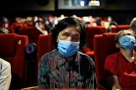 Cinemagoers are told by a narrator what is happening on screen, including facial expressions, unspoken gestures, the setting and costumes (AFP/Jade GAO)