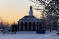 This February 2020 photo provided by Jamie Bolker shows MacMurray College's Henry Pfeiffer Library in the snow at sunset in Jacksonville, Ill. While the school's financial troubles were a long time in the making _ fueled by declining enrollment, an inadequate endowment and competition _ MacMurray spokesman James Prescott said the unlikely prospect of securing funding during or after the economically crippling COVID-19 pandemic helped seal the school's fate. (Jamie Bolker via AP)