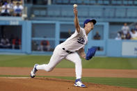 Los Angeles Dodgers starting pitcher Walker Buehler throws to a Houston Astros batter during the first inning of a baseball game Tuesday, Aug. 3, 2021, in Los Angeles. (AP Photo/Marcio Jose Sanchez)
