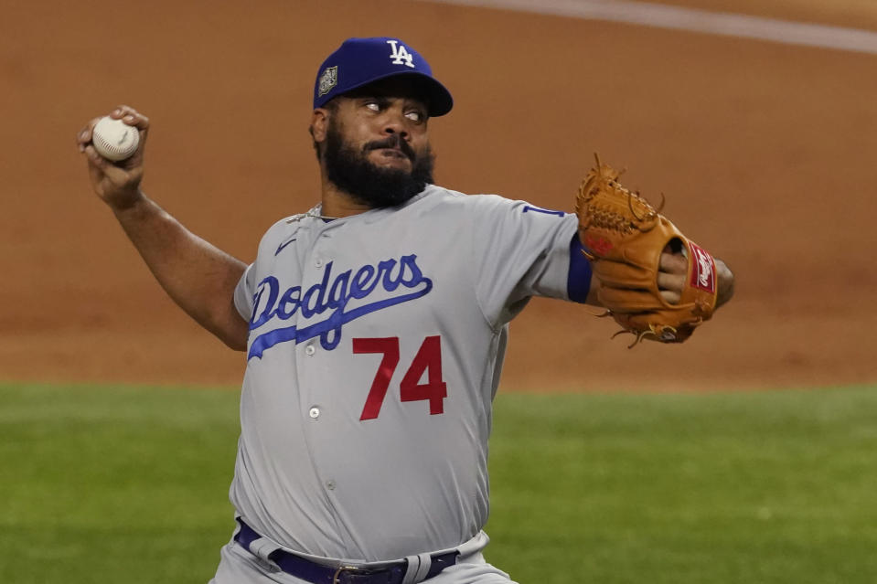 Los Angeles Dodgers relief pitcher Kenley Jansen throws against the Tampa Bay Rays during the ninth inning in Game 3 of the baseball World Series Friday, Oct. 23, 2020, in Arlington, Texas. (AP Photo/Tony Gutierrez)