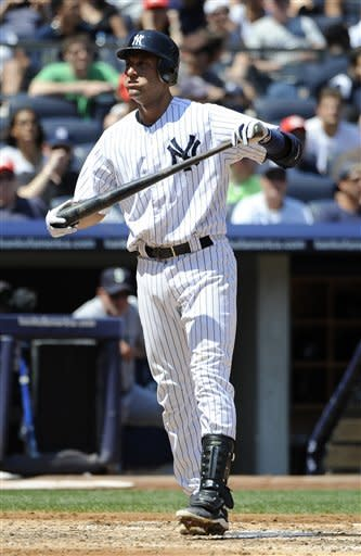 New York Yankees' Derek Jeter reacts after he strikes out against Seattle Mariners starting pitcher Felix Hernandez in the fourth inning of a baseball game on Saturday, Aug. 4, 2012, at Yankee Stadium in New York. The Mariners won 1-0. (AP Photo/Kathy Kmonicek)