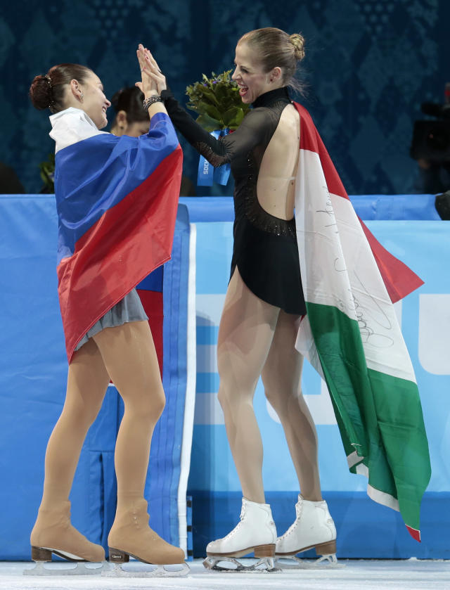Adelina Sotnikova of Russia, left, and Carolina Kostner of Italy celebrate following the women's free skate figure skating finals at the Iceberg Skating Palace during the 2014 Winter Olympics, Thursday, Feb. 20, 2014, in Sochi, Russia. Sotnikova placed first, followed by Kim and Kostner. (AP Photo/Ivan Sekretarev)