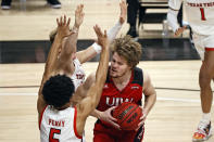 Incarnate Word's Marcus Larsson (15) tries to shoot around Texas Tech's Micah Peavy (5) and Mac McClung (0) during the first half of an NCAA college basketball game Tuesday, Dec. 29, 2020, in Lubbock, Texas. (AP Photo/Brad Tollefson)