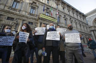 Restaurants and bars owners protest against the government restriction measures to curb the spread of COVID-19, in front of the Milan city hall, Italy, Tuesday, Oct. 27, 2020. Italy's leader has imposed at least a month of new restrictions to fight rising coronavirus infections, shutting down gyms, pools and movie theaters and putting an early curfew on cafes and restaurants. (AP Photo/Luca Bruno)
