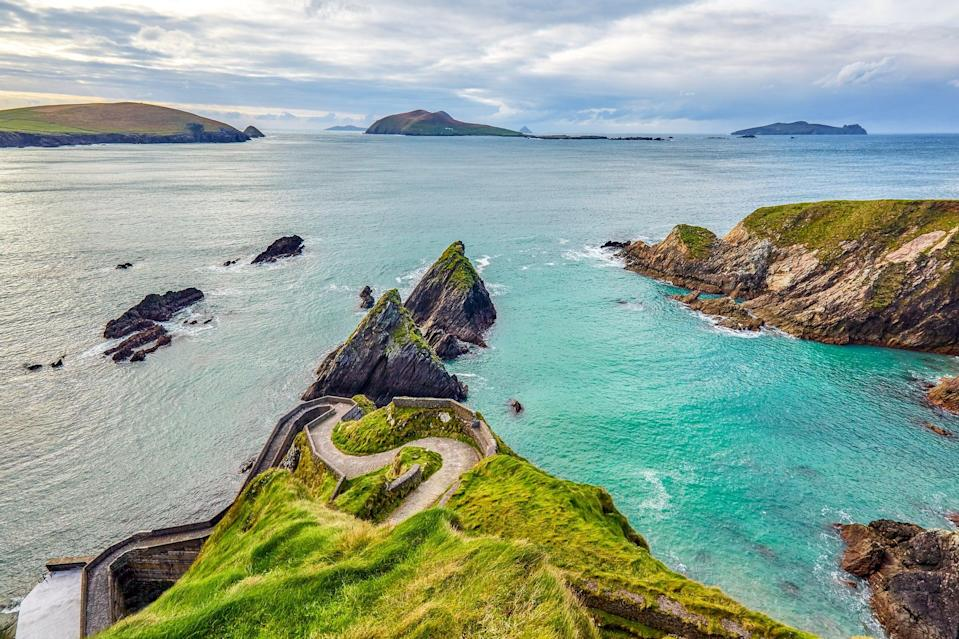 """<p>While in Dingle, make sure you check out Conor Pass, Slea Head Drive (which is part of the Wild Atlantic Way), Dunquin Pier (pictured), and Inch Beach. And if the weather permits, go surfing or kayaking on Dingle's beautiful blue waters. </p> <p>For food, definitely grab ice cream from <a href=""""http://www.murphysicecream.ie/"""" class=""""link rapid-noclick-resp"""" rel=""""nofollow noopener"""" target=""""_blank"""" data-ylk=""""slk:Murphy's"""">Murphy's</a>, enjoy fresh seafood at <a href=""""http://www.outoftheblue.ie/"""" class=""""link rapid-noclick-resp"""" rel=""""nofollow noopener"""" target=""""_blank"""" data-ylk=""""slk:Out of the Blue"""">Out of the Blue</a>, grab your morning coffee from <a href=""""https://www.beanindingle.com/"""" class=""""link rapid-noclick-resp"""" rel=""""nofollow noopener"""" target=""""_blank"""" data-ylk=""""slk:Bean in Dingle"""">Bean in Dingle</a>, and enjoy a few pints of Guinness or cider at <a href=""""https://www.dickmackspub.com/"""" class=""""link rapid-noclick-resp"""" rel=""""nofollow noopener"""" target=""""_blank"""" data-ylk=""""slk:Dick Macks"""">Dick Macks</a> or Foxy John's.</p>"""