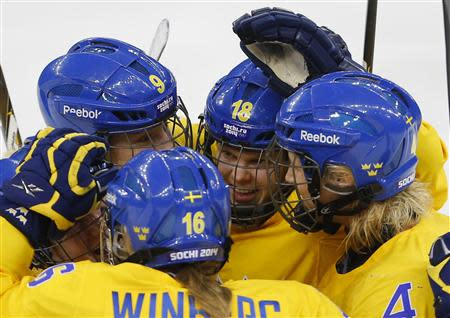 Sweden's Anna Borgqvist (C) celebrates with her teammates after scoring against Team USA during the third period of their women's ice hockey semi-final game at the Sochi 2014 Winter Olympic Games February 17, 2014. REUTERS/Laszlo Balogh