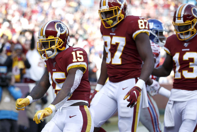 Washington Redskins wide receiver Steven Sims (15) celebrates after scoring on a touchdown pass from quarterback Dwayne Haskins, not visible, during the first half of an NFL football game against the New York Giants, Sunday, Dec. 22, 2019, in Landover, Md. (AP Photo/Patrick Semansky)
