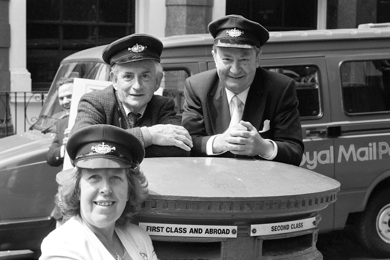 Stars of BBC comedy 'Last of the Summer Wine', Robert Fyfe (l), Peter Sallis (r) and Kathy Staff in London to launch the Royal Mail's new guide to it's postbus network. The service, operated by post-drivers, combine deliveries and collections of mail in country areas with stops on route to pick up and put down passengers