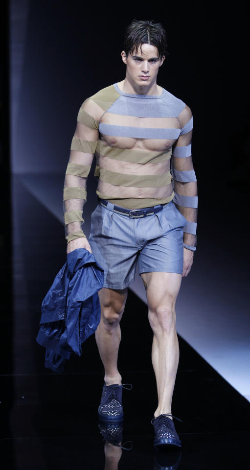 A model wears a creation of Emporio Armani, from the men's Spring-Summer 2013 collection, part of the Milan Fashion Week, unveiled in Milan, Italy, Monday, June 25, 2012. (AP Photo/Luca Bruno)