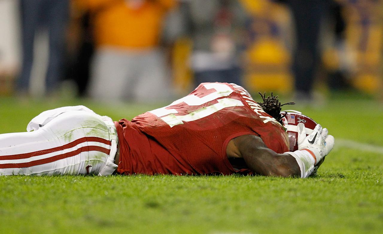 TUSCALOOSA, AL - NOVEMBER 05:  Dre Kirkpatrick #21 of the Alabama Crimson Tide is hurt after a punt during the game against the LSU Tigers at Bryant-Denny Stadium on November 5, 2011 in Tuscaloosa, Alabama.  (Photo by Streeter Lecka/Getty Images)