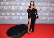 Maya Jama is giving us major old Hollywood vibes. There's something quite Julia Roberts in <em>Pretty Woman</em> about this look, complete with elbow-length velvet gloves. (Getty Images)