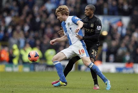 Manchester City's Fernandinho (R) challenges Blackburn Rovers' Chris Taylor during their FA Cup third round soccer match at Ewood Park in Blackburn, northwest England January 4, 2014. REUTERS/Phil Noble