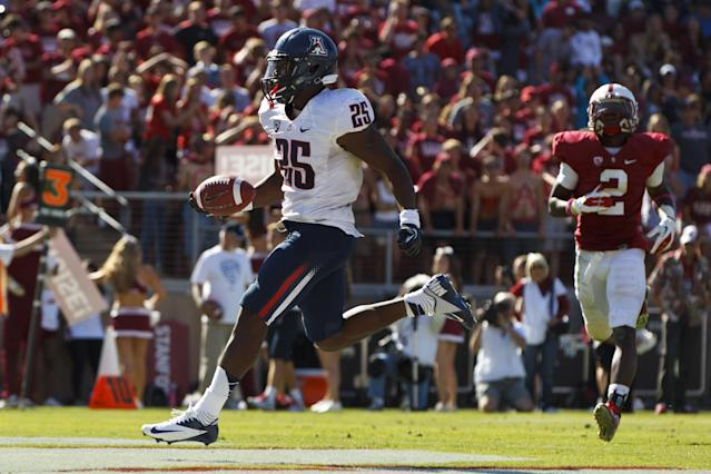 PALO ALTO, CA - OCTOBER 06: Running back Ka'Deem Carey #25 of the Arizona Wildcats scores a touchdown against the Stanford Cardinal during the fourth quarter at Stanford Stadium on October 6, 2012 in Palo Alto, California. The Stanford Cardinal defeated the Arizona Wildcats 54-48 in overtime. (Photo by Jason O. Watson/Getty Images)