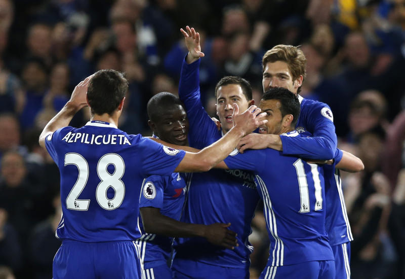 Chelsea players celebrate after Eden Hazard's crucial goal at the Bridge.