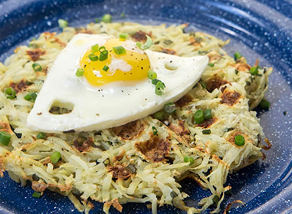 sweet potato and chive hash brown waffles topped with egg