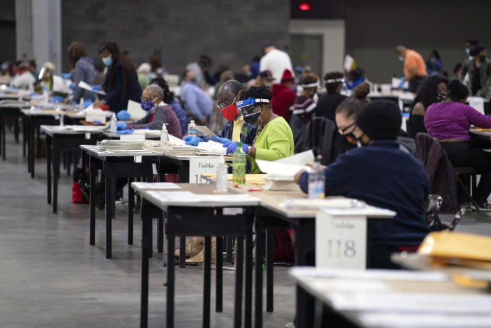 Election workers during the Fulton County ballot recount in Atlanta on Nov. 14, 2020. (Nicole Craine/The New York Times)