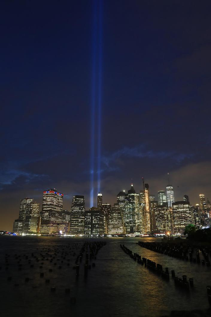 <p>The Tribute in Light rises above the New York skyline from the Brooklyn side of the East River on Sept. 11, 2018. (Photo: Gordon Donovan/Yahoo News) </p>