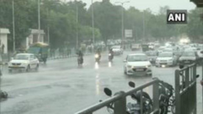 The rain over Delhi was accompanied by a sharp drop in visibility as dark clouds gathered over Delhi-NCR.