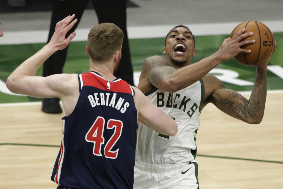 Milwaukee Bucks' Jeff Teague drives to the basket against Washington Wizards' Davis Bertans (42) during the second half of an NBA basketball game Wednesday, May 5, 2021, in Milwaukee. (AP Photo/Aaron Gash)