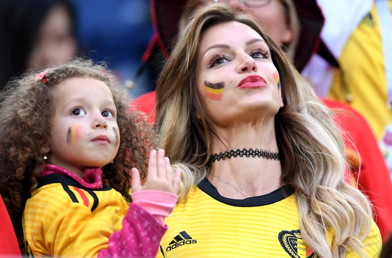 <p>Rafaella Szabo the wife of Axel Witsel of Belgium and her daughter attend the 2018 FIFA World Cup Russia Semi Final match between Belgium and France at Saint Petersburg Stadium on July 10, 2018 in Saint Petersburg, Russia. (Photo by Laurence Griffiths/Getty Images) </p>