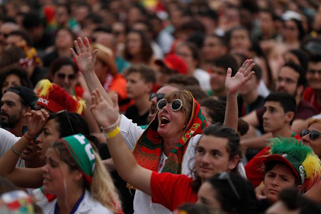 Soccer Football - World Cup - Group B - Portugal vs Morocco - Lisbon, Portugal - June 20, 2018 Fans of Portugal react as they watch the match at a public screening in Lisbon. REUTERS/Rafael Marchante