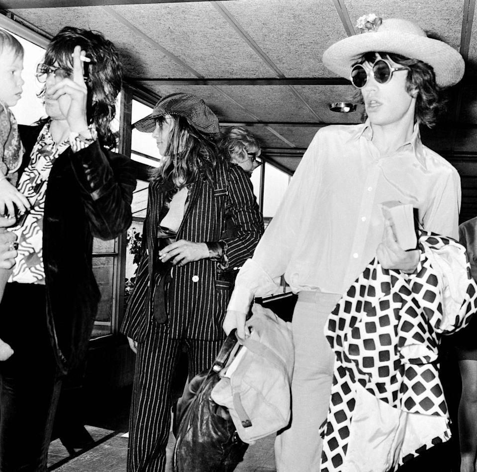 <p>Keith Richards, Anita Pallenberg, their son Marlon and Mick Jagger (right) at London Airport before a flight to Copenhagen, 29th August 1970.</p>