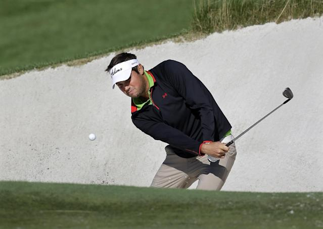 Jeff Overton hits from the sandtrap on the 18th hole during the second round of The Barclays golf tournament Saturday, Aug. 24, 2013, in Jersey City, N.J. Friday's second round finished Saturday after being stopped by darkness. (AP Photo/Mel Evans)