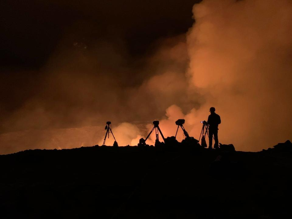 This photo provided by USGS shows scientists on site monitoring the eruption for changes in activity and volcanic hazards in Kilauea volcano's Halemaumau crater at the volcano's summit on Wednesday, Sept. 29, 2021. One of the most active volcanos on Earth is erupting on Hawaii's Big Island. (D. Downs/USGS via AP)