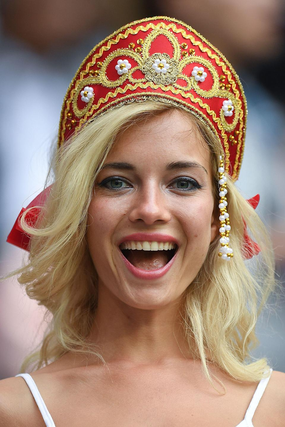 <p>A Russia fan smiles before the start of the Russia 2018 World Cup Group A football match between Russia and Saudi Arabia at the Luzhniki Stadium in Moscow on June 14, 2018. (Photo by Patrik STOLLARZ / AFP) </p>
