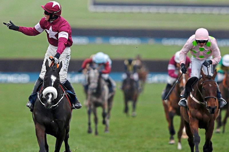 Beaten again: Bryan Cooper celebrates as Don Cossack crosses the line ahead of Djakadam, ridden by Ruby Walsh, in last year's Gold Cup: AFP/Getty Images