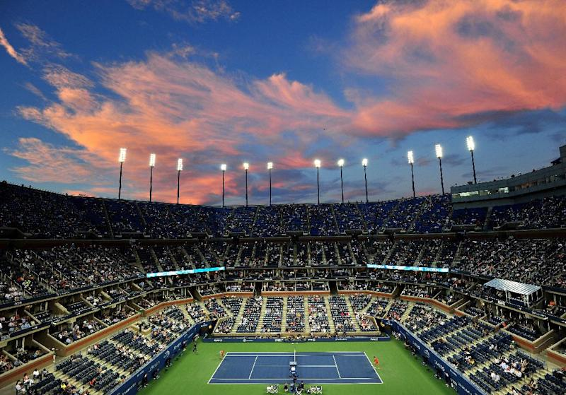 Clouds reflect light from the setting sun over Arthur Ashe Stadium the 2013 US Open at the USTA Billie Jean King National Tennis Center September 4, 2013 in New York