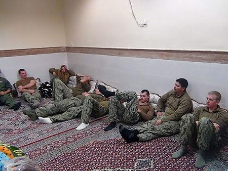 An undated picture released by Iran's Revolutionary Guards website shows American sailors sitting in a unknown place in Iran