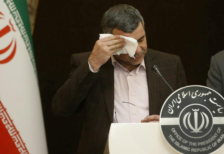 The head of Iran's coronavirus task force, Deputy Health Minister Iraj Harirchi, wipes sweat off his brow as he addresses a news conference hours before he is diagnosed as infected