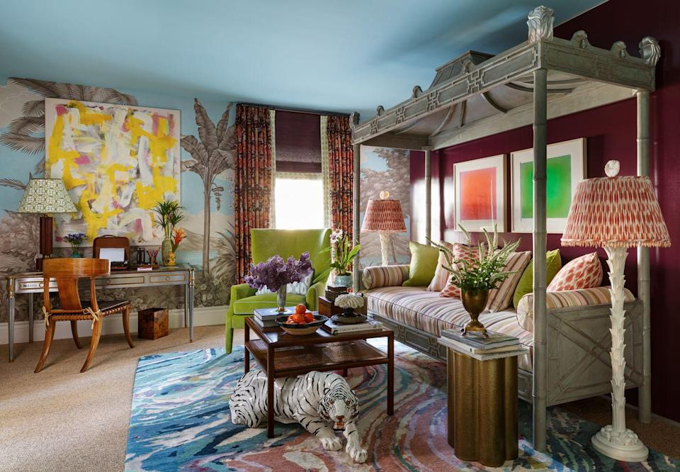 """<p>Riotous shades of blue, raspberry, and yellow reign over this writer's retreat designed by <a href=""""https://www.kevinisbell.com/"""" rel=""""nofollow noopener"""" target=""""_blank"""" data-ylk=""""slk:Kevin Isbell"""" class=""""link rapid-noclick-resp"""">Kevin Isbell</a>. Particularly eye-catching, the Agate rug from <a href=""""https://www.newmoonrugs.com/"""" rel=""""nofollow noopener"""" target=""""_blank"""" data-ylk=""""slk:New Moon Rugs"""" class=""""link rapid-noclick-resp"""">New Moon Rugs</a> offers a extravagant landing spot for a vintage terra-cotta white tiger (<a href=""""https://www.evbantiques.com/"""" rel=""""nofollow noopener"""" target=""""_blank"""" data-ylk=""""slk:Eleish Van Breems"""" class=""""link rapid-noclick-resp"""">Eleish Van Breems</a>). </p>"""