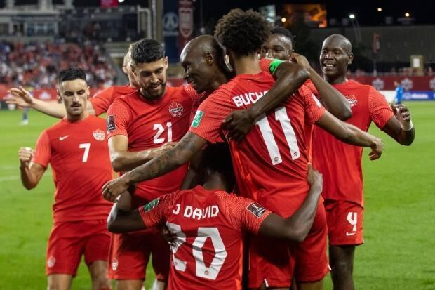 Players celebrate after Tajon Buchanan's second-half goal put Canada up 3-0 over El Salvador on Wednesday. (Chris Young/The Canadian Press - image credit)