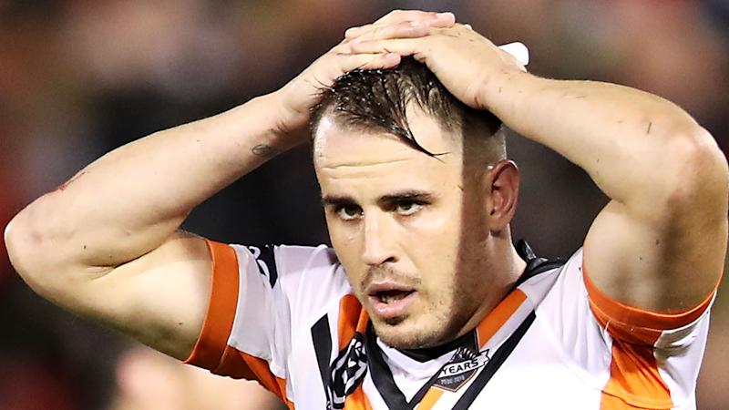 Wests Tigers veteran Josh Reynolds, pictured, has been charged with an alleged domestic violence offence.