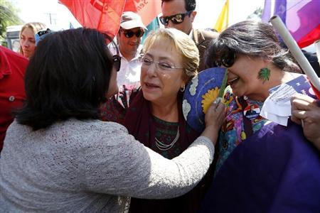 Chilean presidential candidate Bachelet of Nueva Mayoria is welcomed by her supporters during a campaign event in Santiago