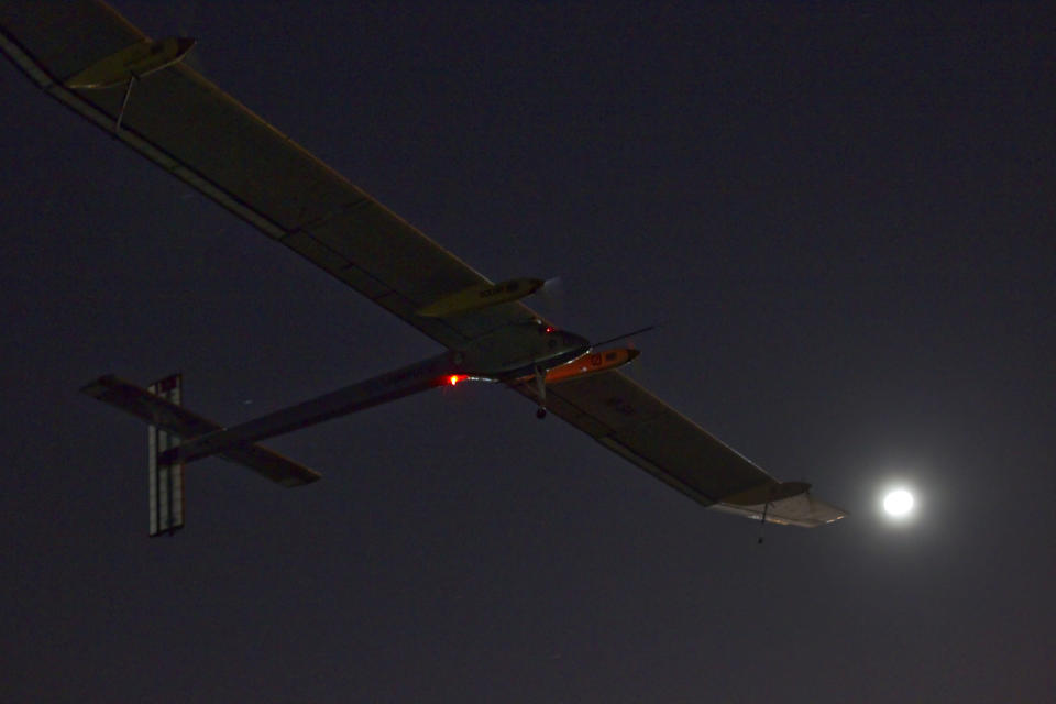 The Solar Impulse HB-SIA experimental aircraft flies after taking off from Barajas airport in Madrid, Spain, in the early hours of Tuesday, June 5, 2012. The zero fuel airplane arrived in Madrid on May 25, 2012 from Payerne, Switzerland, and now goes on to Rabat, Morocco on its first transcontinental trip. The mission is described as the final dress rehearsal for a round-the-world flight with a new and improved aircraft in 2014. (AP Photo/Alberto Di Lolli)