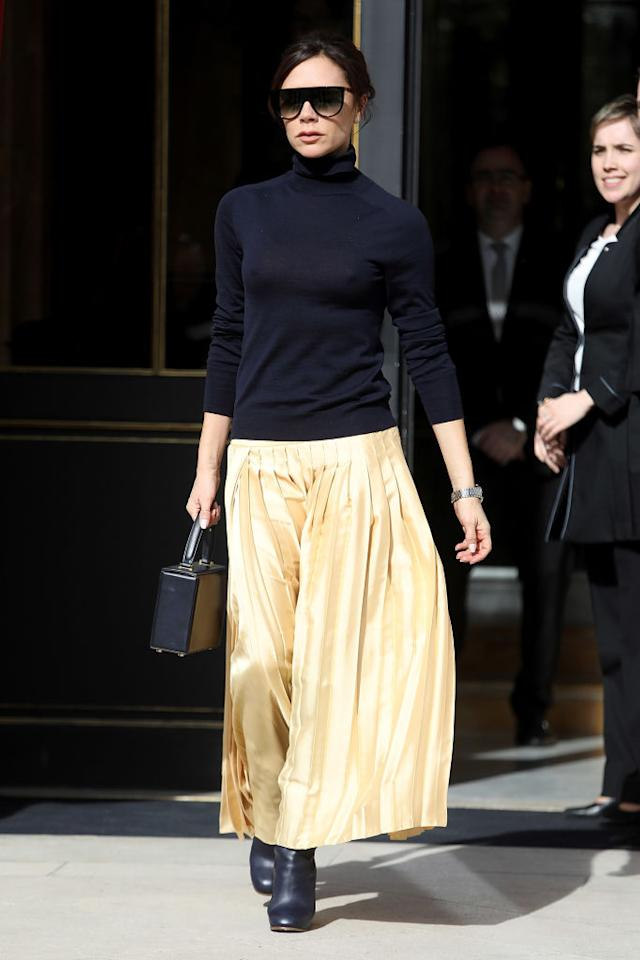 <p>Victoria Beckham was photographed in a spring-ready skirt and navy knit when leaving a hotel in Paris. Hands up, who else is in dire need of a miniature handbag? <em>[Photo: Getty]</em> </p>
