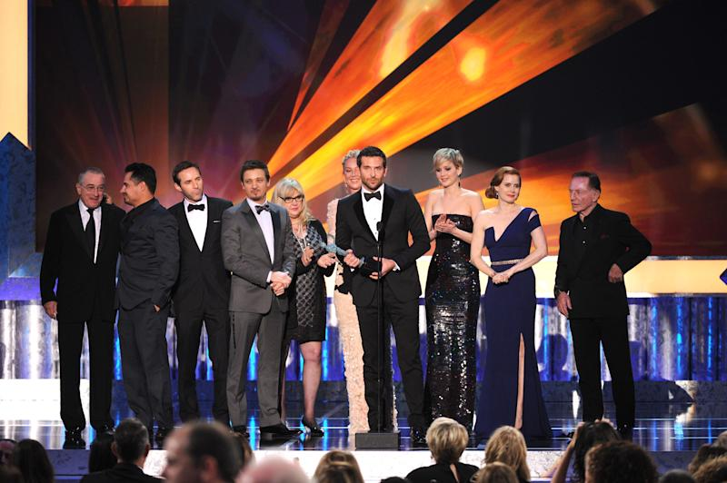 "From left, Robert De Niro, Michael Pena, Alessandro Nivola, Jeremy Renner, Colleen Camp, Elisabeth Rohm, Bradley Cooper, Jennifer Lawrence, Amy Adams and Paul Herman accept the award for outstanding performance by a cast in a motion picture for ""American Hustle"" at the 20th annual Screen Actors Guild Awards at the Shrine Auditorium on Saturday, Jan. 18, 2014, in Los Angeles. (Photo by Frank Micelotta/Invision/AP)"