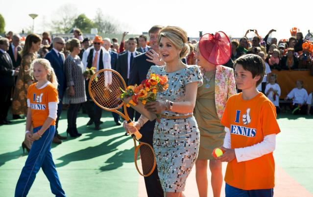 """Queen Maxima of the Netherlands plays tennis during the first King's Day in De Rijp April 26, 2014. The Dutch are celebrating their first ever """"King's Day"""", a national holiday held in honour of the Netherlands' newly installed monarch, King Willem-Alexander. REUTERS/Frank van Beek/Pool (NETHERLANDS - Tags: ROYALS ENTERTAINMENT POLITICS SOCIETY)"""