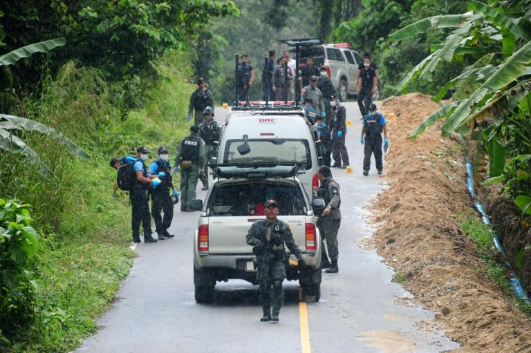 Police investigate the scene of a shooting in Khoksator village in southern Thailand, on March 2, 2017