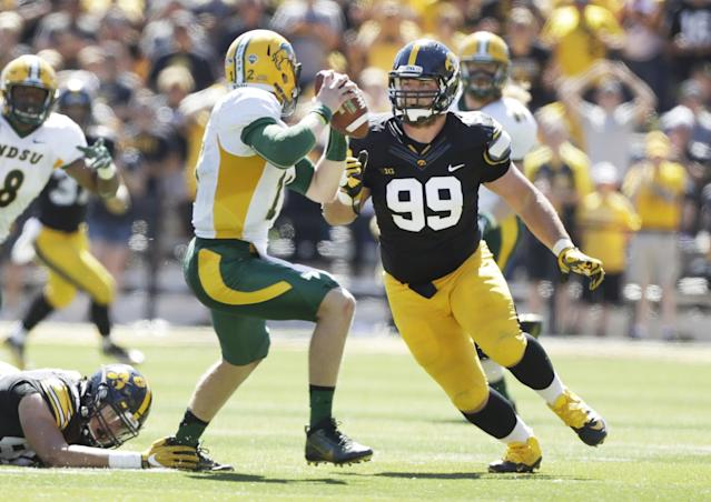 Iowa defensive lineman Nathan Bazata (99) chases North Dakota State quarterback Easton Stick during the first half of an NCAA college football game, Saturday, Sept. 17, 2016, in Iowa City, Iowa. (AP Photo/Charlie Neibergall)