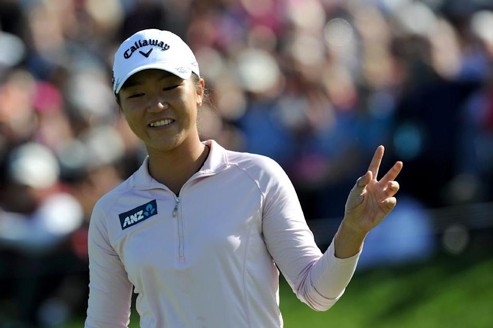 New Zealand's Lydia Ko celebrates after winning the Evian Championship in the French Alps town of Evian-les-Bains, on September 13, 2015 (AFP Photo/Jean-Pierre Clatot)