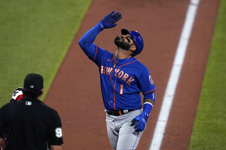 New York Mets' Jonathan Villar celebrates after hitting a solo home run during the fourth inning in the second game of a baseball doubleheader against the St. Louis Cardinals Wednesday, May 5, 2021, in St. Louis. (AP Photo/Jeff Roberson)